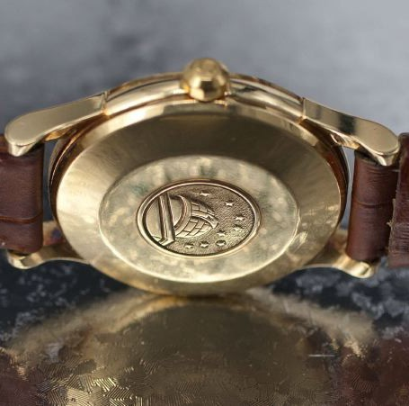 Omega observatory medallion